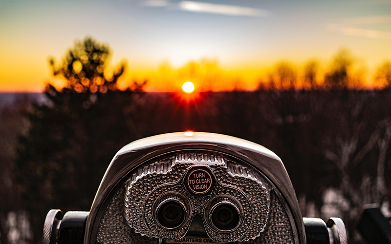 Tower viewer with sunset landscape